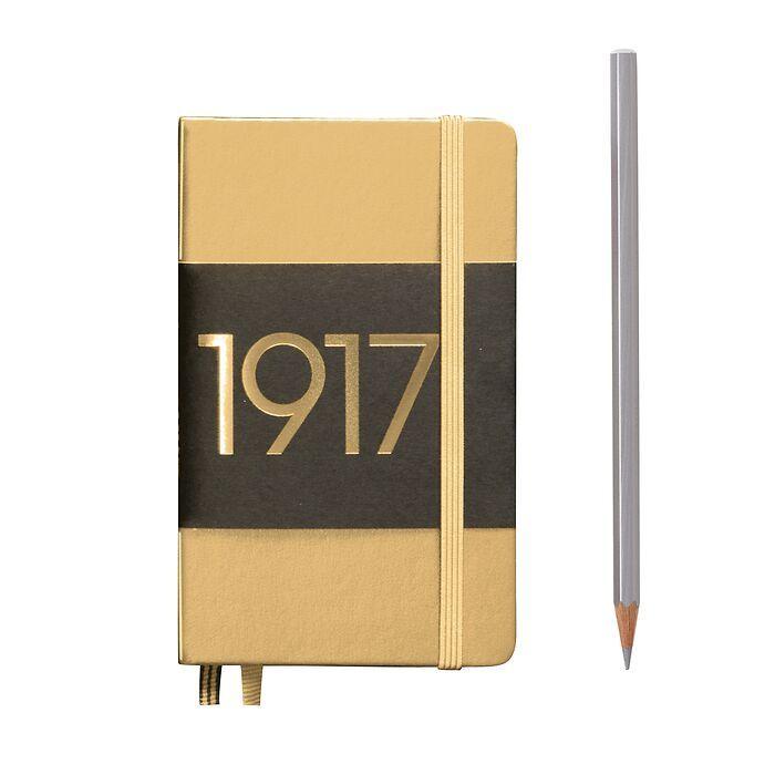 Carnet Pocket (A6) couverture  rigide, 187 pages numérotées, ligné, or